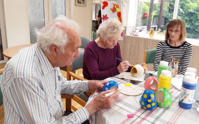 Painting bird feeders at The Old Downs Residential Care Home