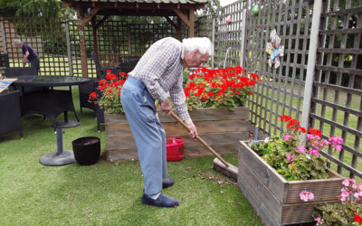 Tidying the garden at The Old Downs Residential Care Home