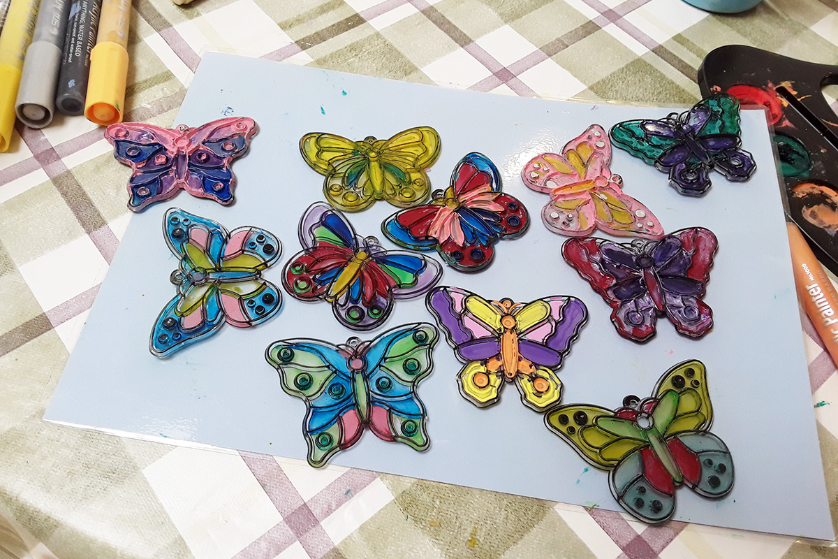 The Old Downs Residential Care Home residents paint butterfly sun catchers